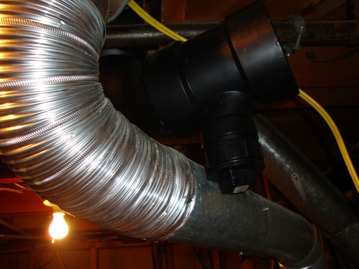 ABS pipe installed with elbow and cleanout